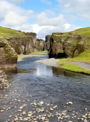 river flowing through canyon in Iceland