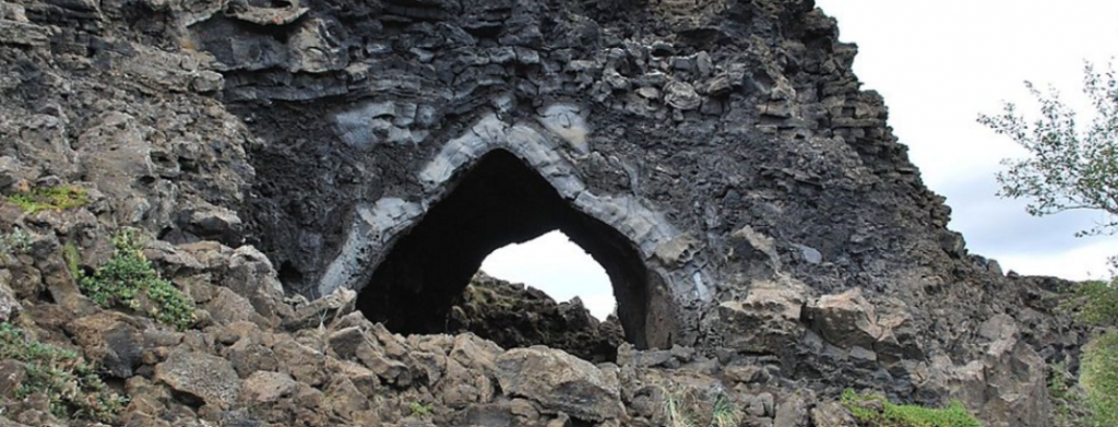 natural tunnel through a rock mound in Iceland