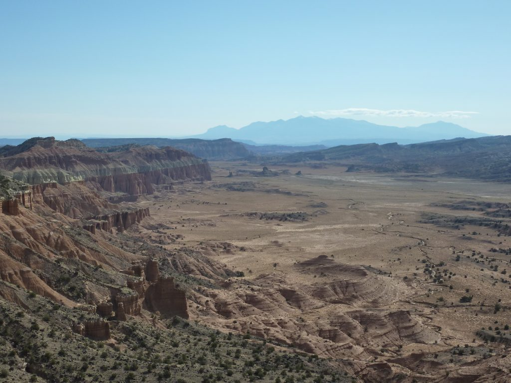 Jeep trail through Upper Cathedral Valley in Capitol Reef National Park, Henry Mountains in the distance