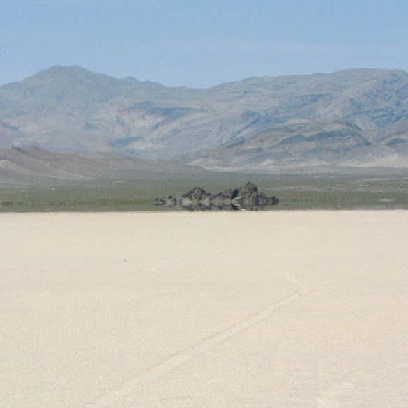 desert playa and grandstand-shaped rock