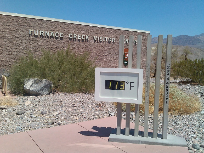A digital thermostat showing temperature (113F) in Death Valley National Parks' Furnace Creek Visitor Center