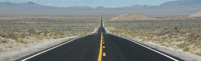 asphalt road through the southwest desert