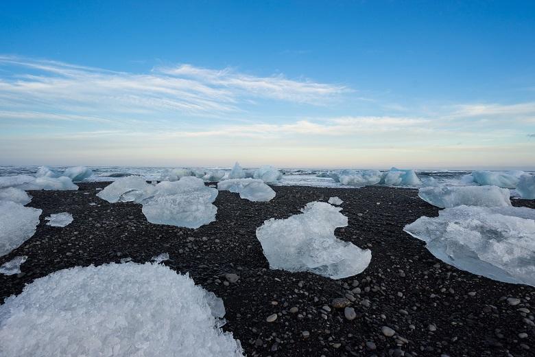 icebergs on black sand