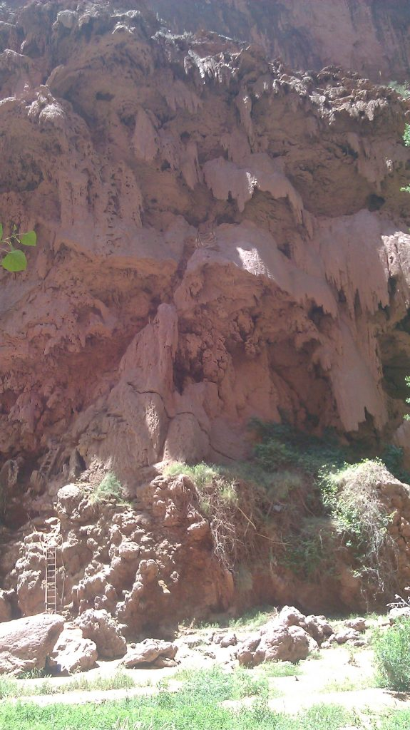 Ladders, caves, tunnels in cliff face