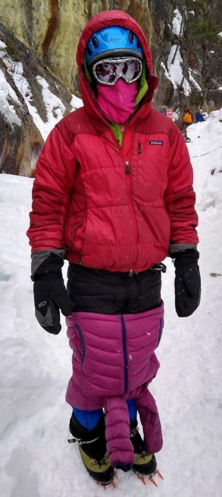 Ice climber wearing all winter layers