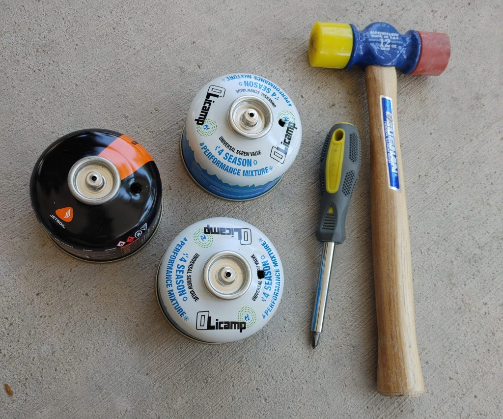 three punctured fuel canisters, screwdriver, hammer