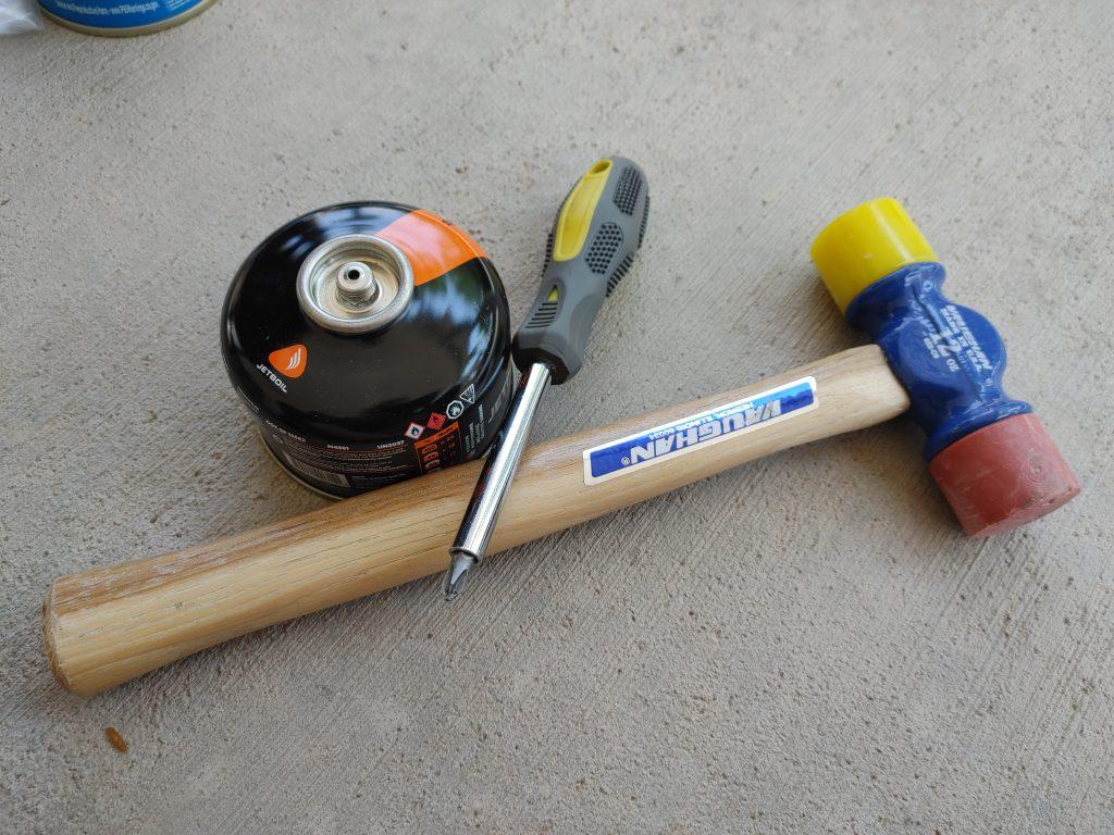 fuel canister, screwdriver, hammer